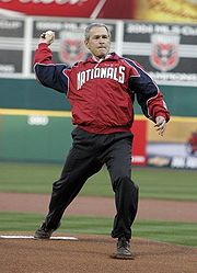 President George W. Bush throws out the ceremonial first pitch at RFK Stadium in Washington DC on April 14 2005.