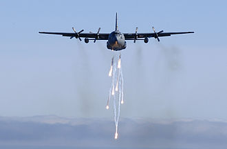 Lockheed C-130 Hercules - A Michigan Air National Guard C-130E dispatches its flares during a low-level training mission