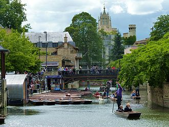 Magdalene Street - Cambridge Quayside and Magdalene Bridge viewed from the boardwalk, with the tower of St John's College New Court in the background.