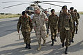 Chairman of the Joint Chiefs of Staff Navy Adm. Mike Mullen, center, speaks with Pakistani Chief of Army Staff Gen. Ashfaq Parvez Kayani, right, and Pakistani army Lt. Gen. Ahmed Shafqaat, left, the commander 100902-N-TT977-016.jpg