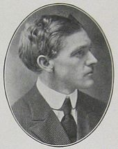 Head and shoulders of a man of about age 35 in profile in an oval frame. He is wearing a dark suit and tie and a white collar. His hair is dark, full, and wavy.