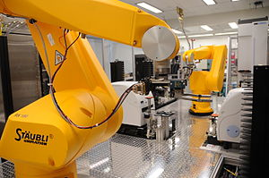Chemogenomics - Chemogenomics robot retrieves assay plates from incubators