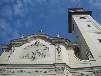 San Lorenzo Martire, Lazzate - Facade with bas relief and belltower.
