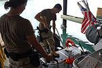Coast Guardsmen Wash Down Their Boat DVIDS178915.jpg