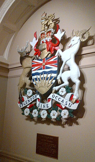 Coat of arms of British Columbia - Coat of arms with motto Splendor Sine Occasu posted on wall inside legislature building