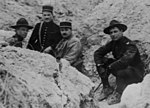 Col. William Mitchell sitting in a shallow trench with three unidentified officers. France? 1918-19 LCCN2002721771 (cropped).jpg