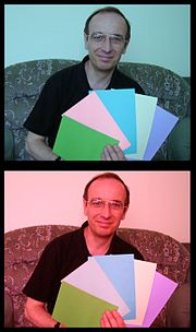 In this illusion, the second card from the left seems to be a stronger shade of pink in the top picture. In fact they are the same colour, but the brain changes its assumption about colour due to the colour cast of the surrounding photo.