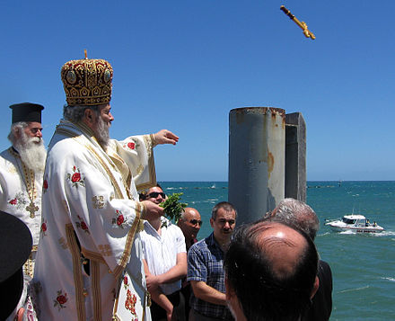 Blessing of the waters and throwing cross; Theophany Cross being thrown at Theophany.jpg