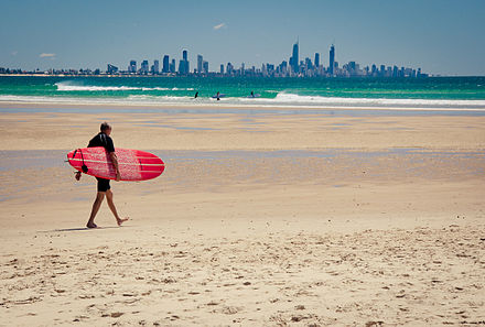 A surfer on the Gold Coast. An iconic global image of Australian tourism focuses on its beaches, which are an integral part of the Australian identity. Currumbin Beach, Queensland, Australia.jpg