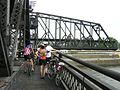 Cyclists on Arsenal Bridge waiting during a bridge opening (2006).jpg