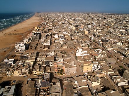Aerial view of Yoff Commune, Dakar Dakar Roofs - Beach & Ocean (5651584098).jpg