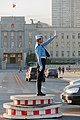 Dalian Liaoning China Police-woman-in-front-of-town-hall-01.jpg