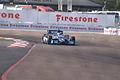 Dallara-Chevrolet DW12 KV-BMC Racing Ruebens Barrichello Morning Practice Through Turn1 fromFence SPGP 24March2012 (14697307564).jpg