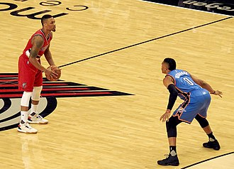 Damian Lillard - Lillard (with the ball) playing for the Blazers while being guarded by Russell Westbrook in 2016.