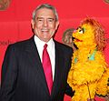 Dan Rather and Kami (the HIV positive muppet) (8226313965).jpg