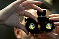 Defense.gov News Photo 110106-N-2055M-063 - U.S. Navy Seaman Garrick Hague adjusts a set of night-vision goggles inside an intermediate maintenance shop aboard the aircraft carrier USS Carl.jpg
