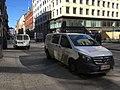Delivery vans on sidewalk (27813176497).jpg