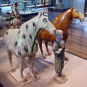 Tang dynasty tomb figures - Two sancai-glazed horses and groom, c. 728, from the tomb of the general Liu Tingxun