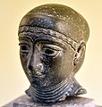 Diorite head of an unidentified woman. Probably from Tell Telloh (Girsu), Iraq. Reign of Gudea, 2144-2124 BCE. Vorderasiatisches Museum, Berlin.jpg