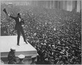 Douglas Fairbanks, movie star, speaking in front of the Sub-Treasury building, New York City, to aid the third Liberty L - NARA - 530736.tif