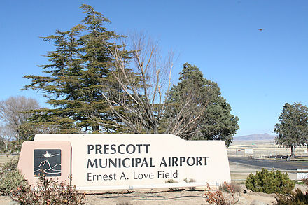 View of airport from Hwy 89 Earnestalovefield sign.jpg