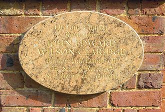 Church of St. Edward the Martyr, Brookwood - Plaque on the exterior wall to John Edward Wilson-Claridge, who recovered the remains of Edward the Martyr