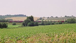 Halle–Hann. Münden railway - In the summer of 2007, a Regionalexpress service crosses the former Inner German Border which ran along the stream in the foreground.