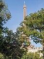 Eiffel tower behind trees (30176538916).jpg