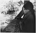 Elderly Native American Woman Weaving a Basket at Oconaluftee Village, NC. - NARA - 281615.tif