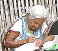 Elderly woman writing in Oaxaca.jpg