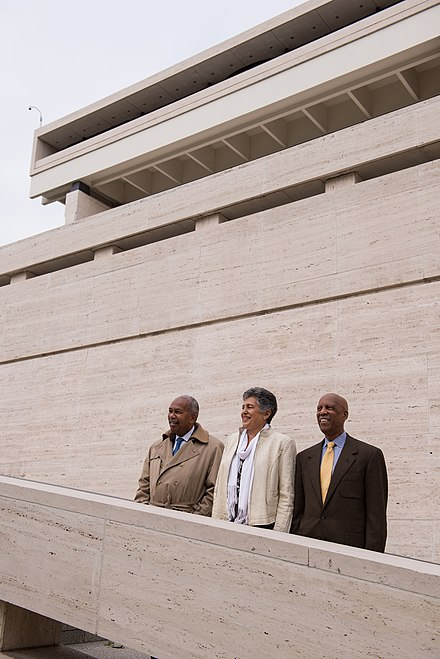 "Three members of the ""Little Rock Nine"" (L-R) Ernest Green, Carlotta Walls LaNier, and Terrence Roberts - stand together on the steps of the LBJ Presidential Library in 2014 Ernest Green, Carlotta Walls LaNier, Terrence Roberts (DIG13683-010).jpg"