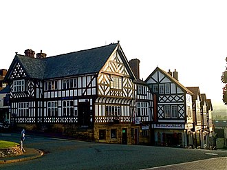 Maen Huail - Exmewe Hall, Ruthin. The stone is against the wall facing the roundabout.