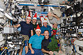 Expedition 30 crew with Santa Claus hats.jpg