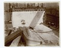 Exterior marble work - a piece of marble in position on the roof, looking north (NYPL b11524053-489536).tiff