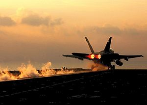 English: F18 taking off the USS Harry Truman F...