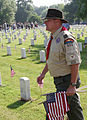 FEMA - 44472 - Boy Scout leader with flags at Nashville National Memorial Cemetery.jpg