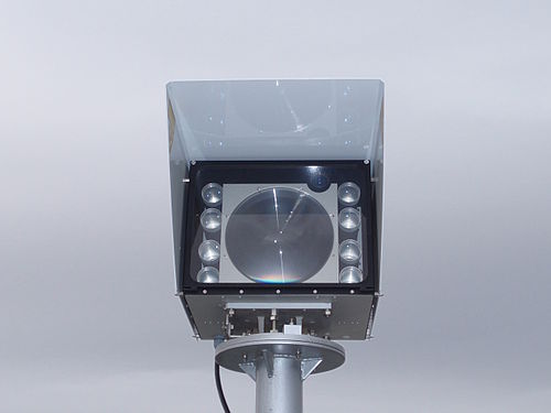 An 8-beam free space optics laser link, rated for 1 Gbit/s. The receptor is the large lens in the middle, the transmitters the smaller ones. At the top right corner is a monocular for assisting the alignment of the two heads. FSO-gigabit-laser-link-0a.jpg