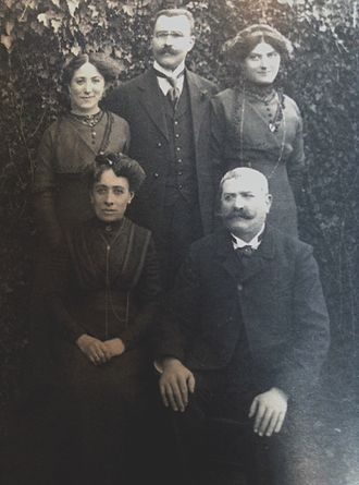 Laure Gatet - Gatet's family in 1912. Standing from left to right: Marie Laure Malassenet, (Laure Gatet's aunt whom she later stayed with) Louis Eugene Gatet, (Laura's father) Marguerite Agathe (her mother) Seated left to right: Marie Laure Martin, wife of Félix and Laure Malassenet maternal grandmother, Felix Malassenet, maternal grandfather of Laura.