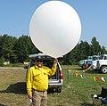 Firefighter with balloon (6068075382).jpg