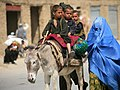 Flickr - DVIDSHUB - A local Afghan family takes a stroll through the local market as ISAF Soldiers conduct a routine village patrol (Image 3 of 31).jpg