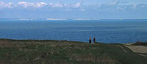 White Cliffs of Dover - The white cliffs of Dover seen across the channel from Cap Gris Nez, France.  The layers of flint embedded in the chalk match on both sides, showing that in prehistoric times a land connection existed between England and France