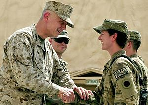 John R. Allen - Marine Gen. John R. Allen, commander of the International Security Assistance Force in Afghanistan, presents his coin to Spc. Carol Sielawa of Bravo Troop, 1st Squadron of the 126th Cavalry Regiment, Michigan Army National Guard, during a command visit to Forward Operating Base Spin Boldak, Afghanistan, July 12, 2012. (U.S. Army photo by Staff Sgt. Brendan Mackie)