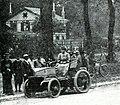 Georges Lemaître bientôt troisième de Paris-Ostende 1899 (ici à Saint-Germain, Mme l'attendant le matin route des Loges, dans la Peugeot).jpg