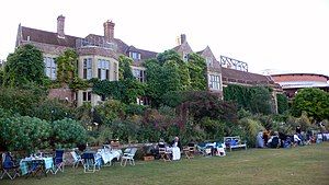 Glyndebourne - Glyndebourne Manor House with the opera house auditorium in the right background, 1 August 2006