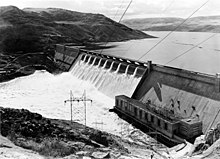Grand Coulee Dam with water coming over central spillway
