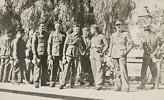Tom Uren - Bombardier Tom Uren (third from left, holding a tin mug and a newspaper) with some of the other members of the 2/1st Heavy Battery in 1941