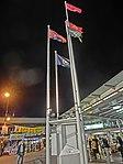 HK TST night Salisbury Road Star Ferry Piers 5 Flagpoles Mar-2013.JPG