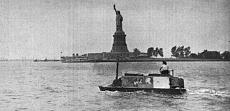 Ben Carlin - The Carlins sailed past the Statue of Liberty in New York Harbor on one of their first circumnavigation attempts in 1948.
