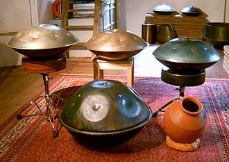 Hang (instrument) - Front line: Prototype Hang from November 1999 (left), Ghatam (right); second line: Three Hanghang built in 2007, 2006 and 2005 respectively (from the left to the right)