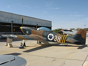 History of the Israeli Air Force - P-51D at the Israeli Air Force Museum; the marking beneath the cockpit notes its participation in the wire-cutting operation at the onset of the Suez Crisis.